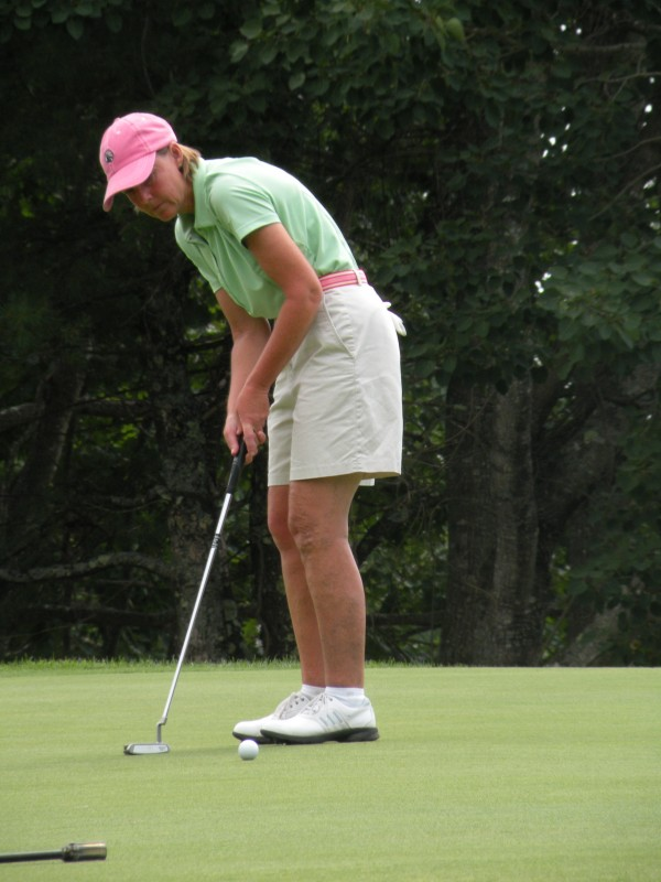 Leslie Guenther of Norway Country Club sinks a par putt on the 16th hole at Augusta Country Club in Manchester in the second round of the Maine Women's Amateur Golf Championship on Tuesday, July 24, 2012. Guenther posted her second straight 79 and leads by one stroke.