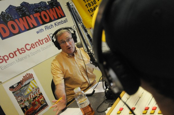 In the studio at Blueberry Communications in Bangor, Rich Kimball, host of Downtown with Rich Kimball, delivers his afternoon radio sports broadcast with producer reporter Brian Stackpole Wednesday afternoon, July 25, 2012.