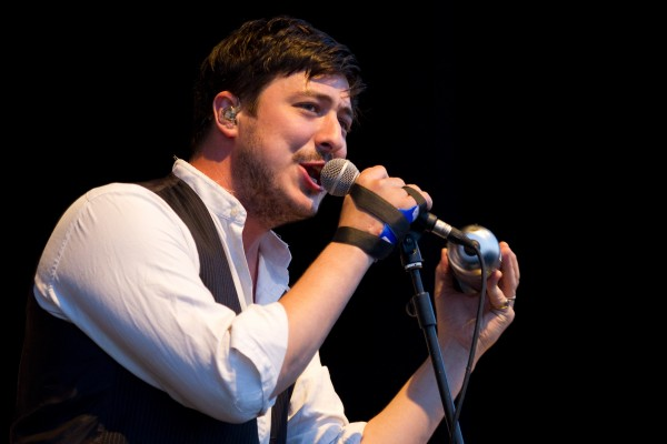 Marcus Mumford, lead singer of British folk rock band Mumford & Sons, performs during their concert at the Optimus Alive music festival in Lisbon on Saturday, July 14, 2012.