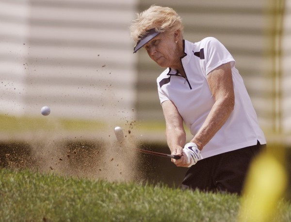Pennie Cummings of Wayne hits out of the hazard on the final hole of the Maine Women's Amateur golf tournament at the Augusta Country Club on Wednesday, July 25, 2012.