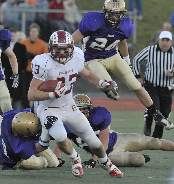 Bangor's Josiah Hartley tries to get some yardage during the Class A state final against Cheverus on Nov. 20, 2010. Hartley has left the University of Maine football team after one season.
