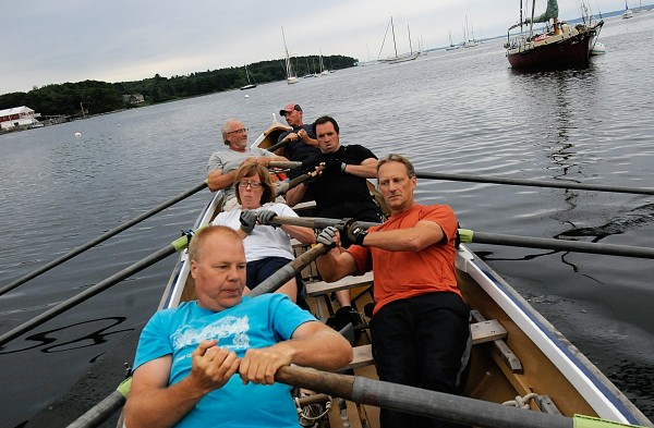 Jonathan Fulford of Monroe (from front to back), John Dillenbeck of China, Amy Grant of of Belfast, Ethan Shaw of Belfast, Greg Stafford of Monroe and Aaron Bauman of Belfast train at just under 30 rowing strokes per minute aboard the team's 32-foot Cornish pilot gig in Belfast harbor Thursday evening, July 26, 2012. Their Come Boating! team recently won the 20-mile Blackburn Challenge, circumnavigating Cape Ann near Gloucester, Mass. Not only did they win, they may have set a course record.