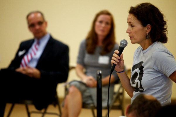 Lisa Hicks, parent of a child at Ocean Avenue Elementary School, adresses a panel of Portland School District officials Thursday night, Juy 19, 2012 about concerns over potential overcrowding in the fall that may displace the art and music programs from their rooms.