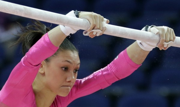 U.S. gymnast Kyla Ross performs on the uneven bars during training at the 2012 Summer Olympics, Thursday, July 26, 2012, in London.