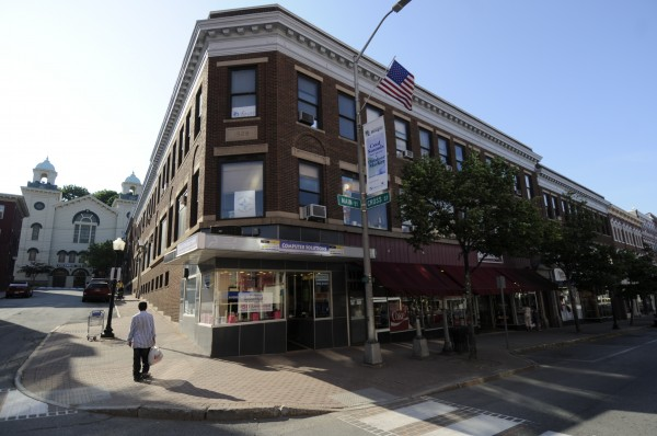 The Coe Building is seen at the corner of Main and Cross streets in downtown Bangor on Sunday afternoon, July 22, 2012.