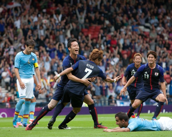 Japan's players react in celebration after Yuki Otsu scores the opening goal during the group D men's soccer match between Japan and Spain at the London 2012 Summer Olympics, Thursday, July 26, 2012, at Hampden Park Stadium in Glasgow, Scotland.