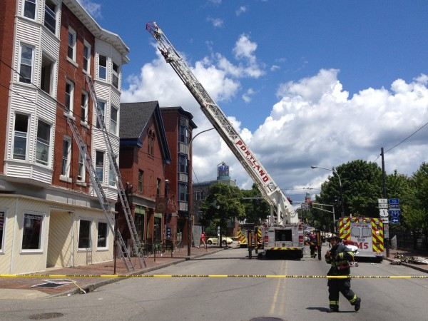 Congress Street in Portland was blocked off after fire a fire started at an apartment house on Monday, July 2, 2012.