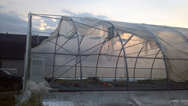 A greenhouse in Hudson was blown several hundred yards by a storm that hit the area late Saturday afternoon.