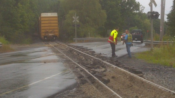 Route 15 was damaged when a train heading away from Verso Paper overturned Sunday.