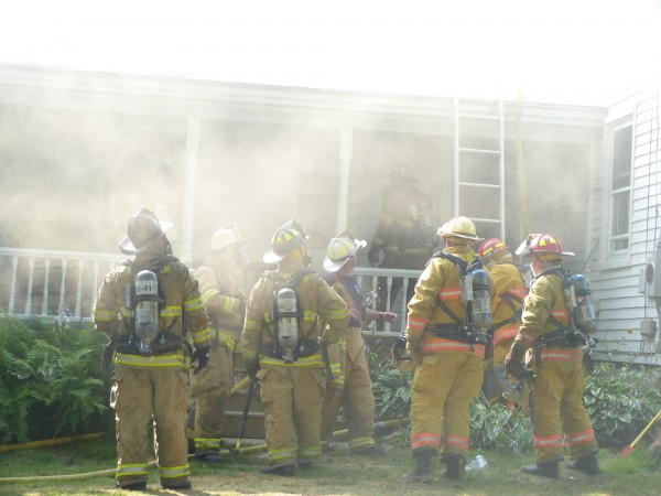 Firefighters battled a fire at a two-story farmhouse at 246 Coombs Road in Brunswick on Friday, July 13, 2012.