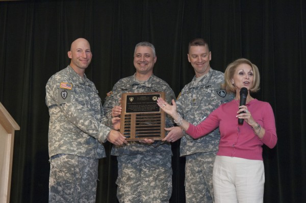 Chief Warrant Officer 2 Andrew J. Marquis, Capt. Steven Morin and Maj. Daniel Curtis receive an award for the 133d Engineers for 20 years of service from Anna Gould, founder of Camp Sunshine.