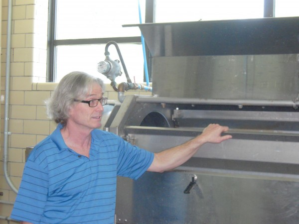 General Manager Chris Hallweaver describes the potato peeling machine used by Northern Girl in the NCO club kitchen at the former Loring Air Force Base in Limestone.