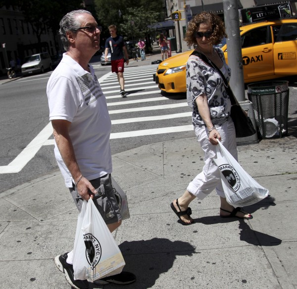 Jason Marder walks home with his wife, Karin Marder, after visiting a grocery store in New York. Jason Marder, who turned 70 on Tuesday, July 10, 2012, was diagnosed with Alzheimer's more than eight years ago.
