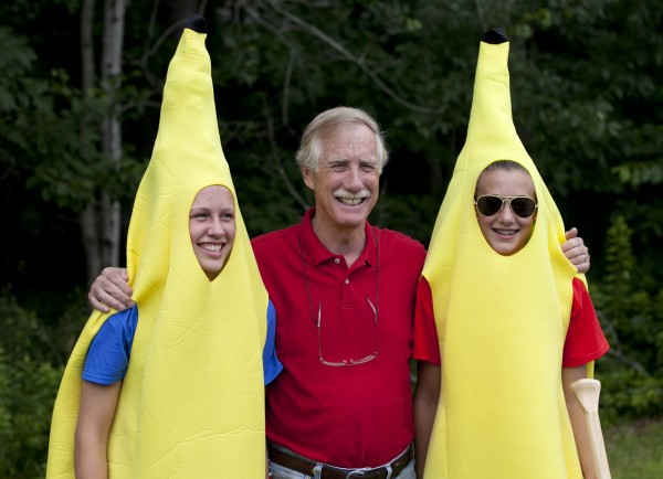 Angus King, independent candidate for U.S. Senate, poses with Ann Tolan and Noa Sreden, the Banana Splits from Dots Ice Cream shop, prior to the start of the Bath Heritage Days parade on Wednesday.