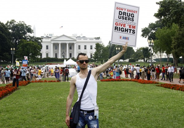 Vincent Leclercq of France demonstrates in front of the White House in Washington on Tuesday, July 24, 2012, as the AIDS conference continues in Washington.