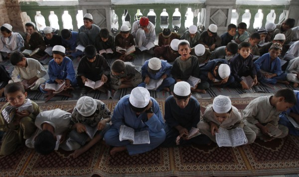 Afghan boys read the Quran during the Muslim holy month of Ramadan at a mosque in the city of Jalalabad, the provincial capital of Nangarhar province, east of Kabul, Afghanistan, Sunday, July 22, 2011. Muslims from Morocco to Afghanistan are experiencing the toughest Ramadan in more than three decades with no food or drink, not even a sip of water, for 14 hours a day during the hottest time of the year.