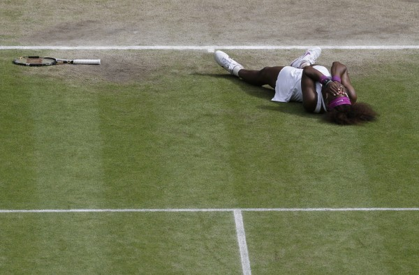 Serena Williams of the United States reacts after defeating Agnieszka Radwanska of Poland to win the women's final match at the All England Lawn Tennis Championships at Wimbledon, England on Saturday, July 7, 2012.