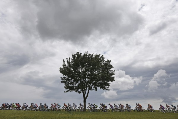 The pack rides under menacing skies during the sixth stage of the Tour de France cycling race over 129 miles with start in Epernay and finish in Metz, France on Friday, July 6, 2012.