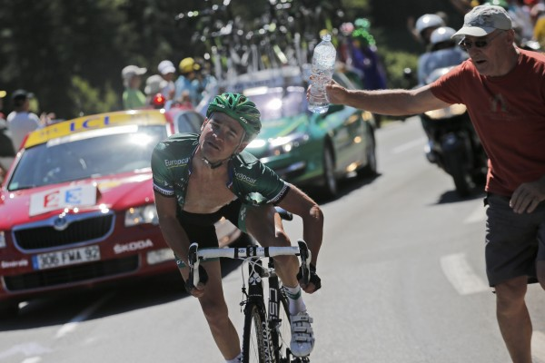 Stage winner and new best climber Thomas Voeckler of France avoids being sprayed with water by a spectator as he climbs Peyresourde pass during the 16th stage of the Tour de France cycling race over 122.4 miles with start in Pau and finish in Bagneres-de-Luchon, France on Wednesday, July 18, 2012.