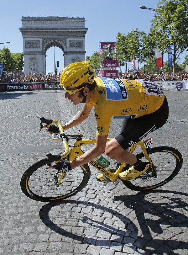 Bradley Wiggins of Britain, wearing the overall leader's yellow jersey cycles past the Arc de Triomphe during the 20th stage of the the Tour de France cycling race over 120 kilometers (74.6 miles) with start in Rambouillet and finish in Paris, France, Sunday July 22, 2012.