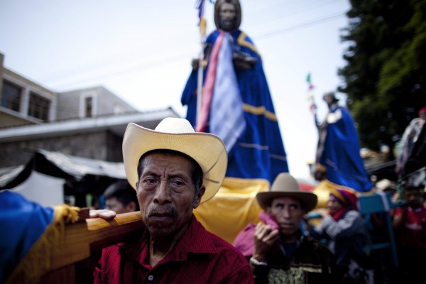 Faithful carry religious statues during a procession honoring St. James the Apostle in Santiago Atitlan, Guatemala on Wednesday, July 25, 2012. The tradition of honoring St. James or Santiago in Spanish, goes back to when the conquistadors arrived in the Americas, renaming many communities after their patron saint, which is the patron saint of Spain today. His feast day is July 25.