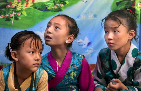 Tibetan schoolgirls wait for the arrival of spiritual leader the Dalai Lama for a function at the Tibetan school in Srinagar, India on Saturday, July 14, 2012. The Dalai Lama is on a four-day visit to the troubled portion of Indian Kashmir.