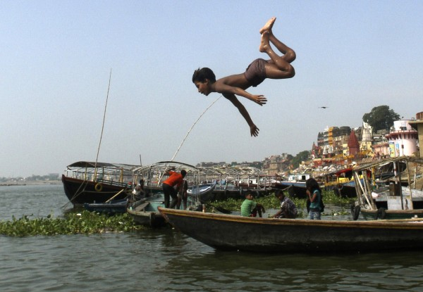 An Indian child dives into the River Ganges in Varanasi, India on Tuesday, July 10, 2012. Varanasi, also known as Kashi and Benaras, is Hinduism's holiest city.