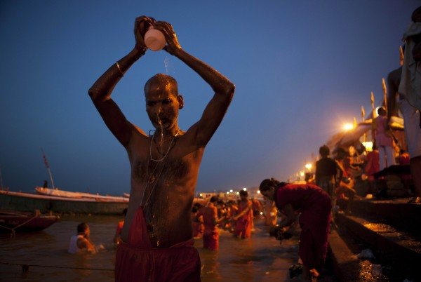 Hindu devotees bathe in the early morning hours at the River Ganges in Varanasi, India on Wednesday, July 11, 2012. Varanasi, also known as Kashi and Benaras, is Hinduism's holiest city.