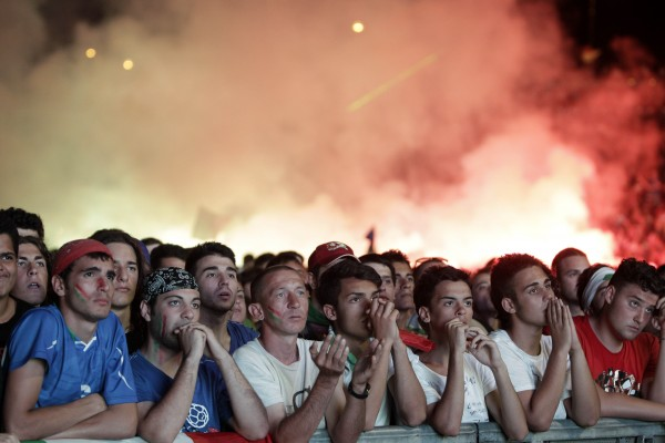 Italian fans react at the Circus Maximus in Rome, during the Euro 2012 soccer championship final match between Italy and Spain on Sunday, July 1, 2012