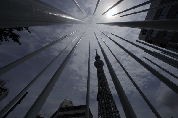 The Tokyo Skytree soars behind an art work in Tokyo on Friday, July 13, 2012.