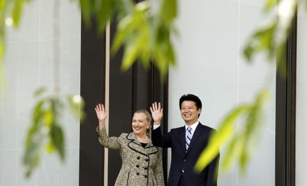 U.S. Secretary of State Hillary Rodham Clinton (left) and Japanese Foreign Minister Koichiro Gemba wave before a working lunch in Tokyo on Sunday, July 8, 2012.