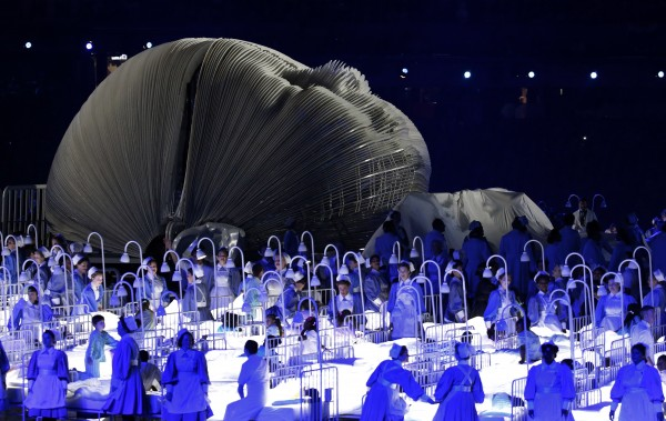 Actors perform in a sequence meant to represent Britain's National Health Service (NHS) during the Opening Ceremony at the 2012 Summer Olympics on Friday, July 27, 2012, in London.