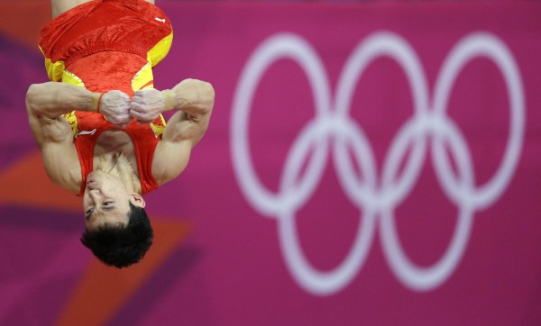 China's Feng Zhe trains on the vault during a practice session ahead of the 2012 Summer Olympics on Wednesday, July 25, 2012, in London.