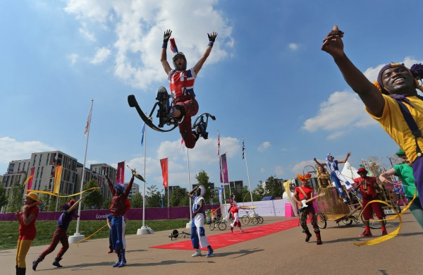 Dancers perform during a ceremony to welcome athletes from Syria for the 2012 Summer Olympics at Olympic village on Wednesday, July 25, 2012, in London.