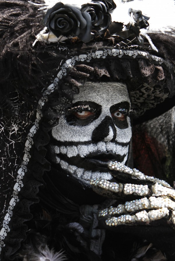 A person in a &quotCatrina&quot costume gestures for a portrait during a gay pride parade in Mexico City on Saturday, June 30, 2012.