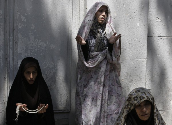 Iranian women pray outside Tehran University in Tehran, Iran, on Friday, July 27, 2012, during Muslims holy month of Ramadan. Ramadan is the ninth month of the Muslim year which lasts 30 days during which strict fasting is observed from sunrise to sunset.