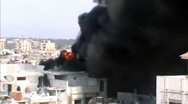 This image made from amateur video released by Shaam News Network and accessed by the Associated Press Saturday, July 21, 2012 purports to show the spread of fires as a result of the shelling of Homs, Syria by government forces on July 21, 2012.