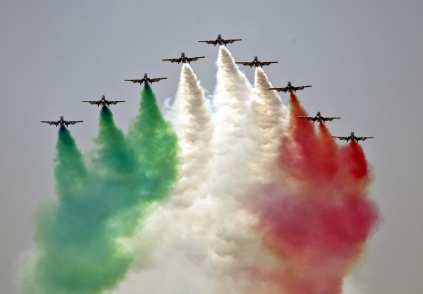 Aircraft of the Frecce Tricolori, the demonstration team of the Italian Air Force, perform during an air show in Bucharest, Romania, Saturday, July 21, 2012.