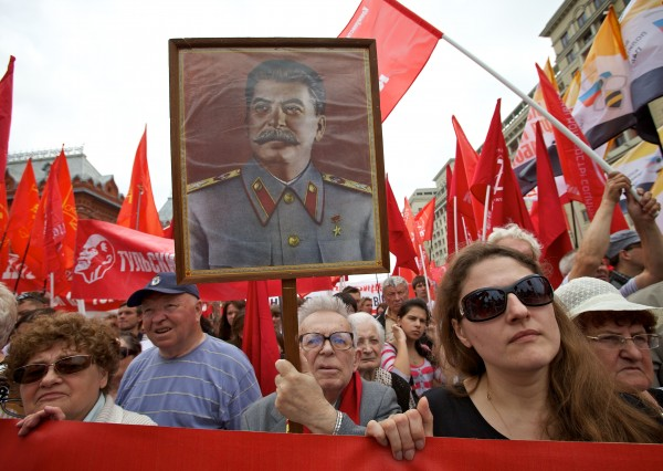 Supporters of the Communist Party hold a portrait of Soviet dictator Josef Stalin during a rally against joining the World Trade Organization next to Red Square in Moscow,  Russia, Tuesday, July 3, 2012. Hundreds of people waving communist and imperial flags have protested in central Moscow against Russia''s upcoming entry into the World Trade Organization.