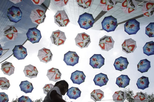 Umbrellas are displayed over a street in a sales promotion of a store in Seoul, South Korea on Wednesday, July 25, 2102.