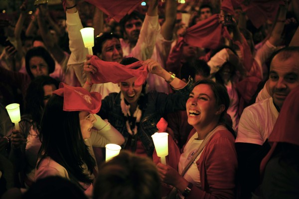 Revelers gather to mark the end of the San Fermin fiestas, in Pamplona northern Spain on Saturday, July 14, 2012. The festival of San Fermin will end at midnight Saturday, with revelers singing ''Pobre de Mi,&quot a song which can be translated as &quotwoe is me.&quot