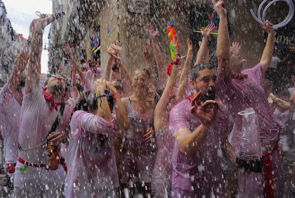 Revelers enjoy water throwing from a balcony during the Chupinazo, the official opening of the San Fermin fiestas in Pamplona, northern Spain on Friday, July 6, 2012 to celebrate the start of Spain's most famous bull-running festival. Perhaps best glorified by Ernest Hemingway's 1926 novel &quotThe Sun Also Rises,&quot the San Fermin festival is known around the world for the daily running of the bulls.