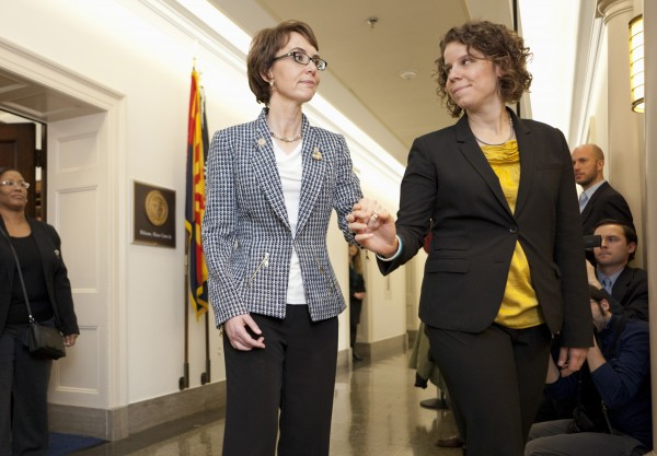 Rep. Gabrielle Giffords, D-Ariz., assisted by her chief of staff, Pia Carusone, leaves her office on Capitol Hill in Washington for the last time as a member of Congress, Wednesday, Jan. 25, 2012. Earlier, in a House occasionally known for untoward exits, Giffords stood among cheering, crying colleagues to say goodbye Wednesday, over a year after she was gravely wounded by a would-be assassin.