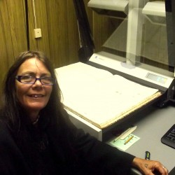 Archivist Susan Wright uses specialized computer software imported from Germany to scan old editions of Washington County newspapers. Some issues of the Eastport Sentinel date back to the mid-1800s.