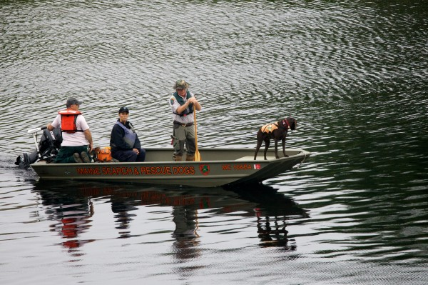 A Maine search and rescue dog team scours the Kennebec River between Waterville and Winslow on Tuesday July 17, 2012, looking for missing toddler Ayla Reynolds.