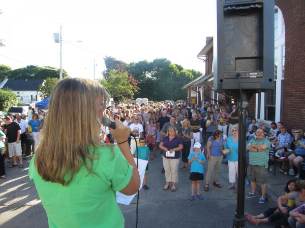Tiffany Monroe speaks to some of the more than 500 people who gathered Monday night outside the Trackside Station restaurant in Rockland to raise money for the family of Noah Keene, whose hand was severed in a freak accident last month.