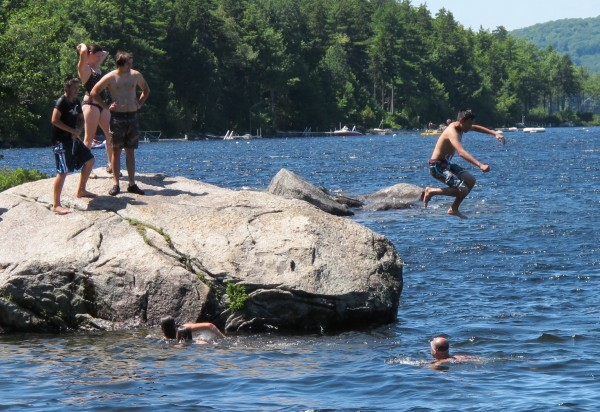 Beach goers  leap into a deep portion of Branch Lake at the state-owned beach near Branchview Drive on Monday, July 9, 2012. The popular swimming spot is a few hundred feet from where the state is building a new public boat launch after years of negotiation with the city.