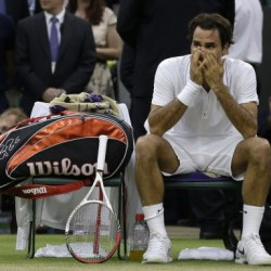 Federer crushes suffering Cilic for record eighth Wimbledon title