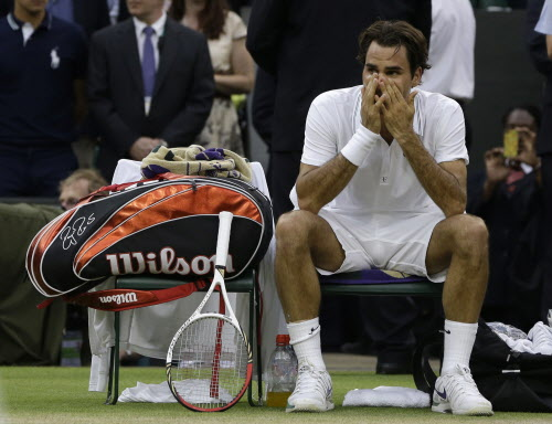 Roger Federer of Switzerland reacts after winning the men's singles final against Andy Murray of Britain at the All England Lawn Tennis Championships at Wimbledon, England on Sunday, July 8, 2012.