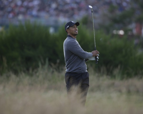 Tiger Woods plays a shot on the 16th hole at Royal Lytham & St Annes golf club during the second round of the British Open Golf Championship, Lytham St Annes, England, Friday, July 20, 2012.